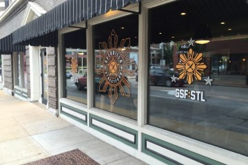 The wide storefront windows of Guerrilla Street Food's brick-and-mortar location.
