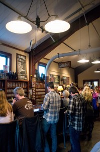 Customers stand in line at the Civil Life's cash-only bar. The Civil Life is known for its malt-driven, sessionable and well-crafted beers.