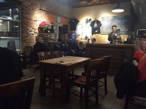 A band plays in the background as customers drink Urban Chestnut's Reverence Series at their Midtown location. The Reverence Series features traditional European styles, while the Revolution Series features experimental and craft styles.