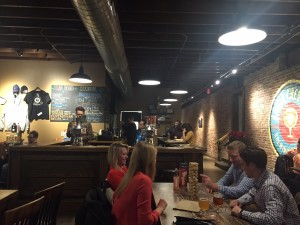 Several customers play Jenga while sipping on their Urban Chestnut brews. The brewpub often offers live entertainment and games to customers while they drink.