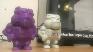 A bulldog stressball stands next to a purple, plastic replica.  ITS is testing a 3-D printer on Truman's campus.  Photo Credit: Bethany Boyle