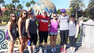 Truman softball players pose in front of the Universal Studios statue while in Florida. The 'Dogs went 7-1 during their eight games in the Sunshine State. Photo Credit: Submitted Photo