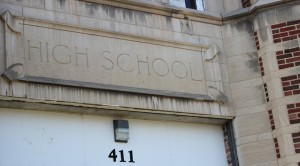 The stone marker above the south entrance of the old Kirksville High School shows the building's original purpose.