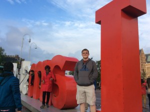 """Dustin next to the famous """"I Amsterdam"""" sign."""