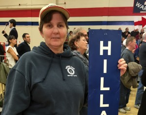 Sandy Galer has supported the Clinton family since Bill Clinton's time as president. Galer holds a rally poster from Hillary Clinton's '08 campaign in Denver, Co.