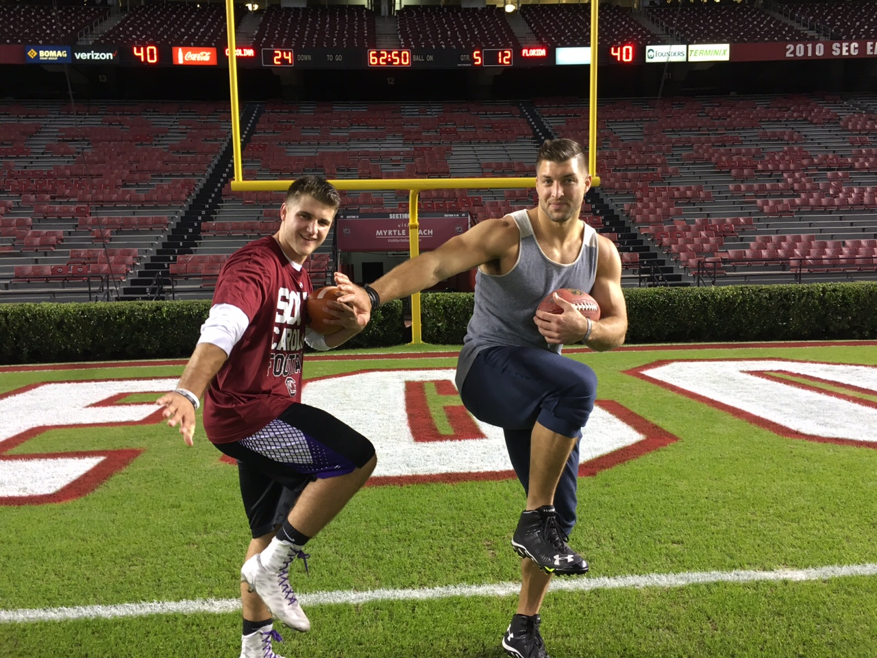 Freshman quarterback Jaden Barr performs the Heisman pose with former Heisman Trophy winner Tim Tebow at William-Brice Stadium at the University of South Carolina. Submitted by Jaden Barr