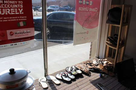 Along with traditional West and Central African clothing Kondi's store has sandals to complete a customer's ensemble.