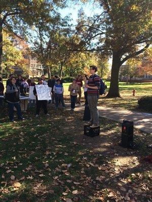 Junior Ian Pratt speaks out against Trump at SDS's Dump Trump Rally.