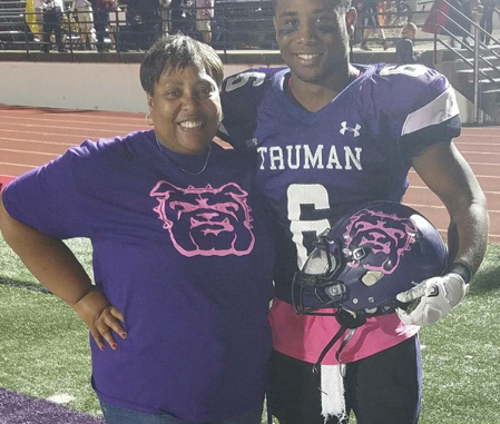 Senior defensive back Jordan Brown stands with his mother Pam Brown. He wears pink to support her battle with breast cancer.