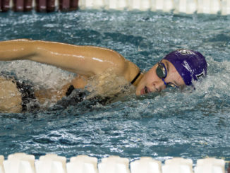 A picture of senior Jasmine Roghair swimming.