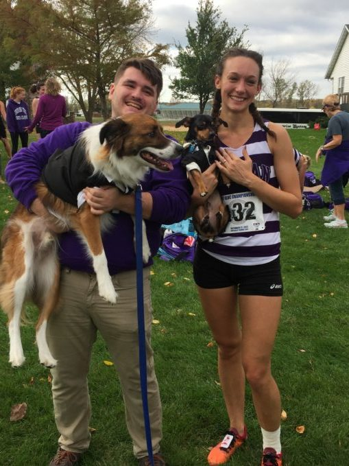 A picture of seniors Joey Parisi and Michaela Hylen with their dogs.