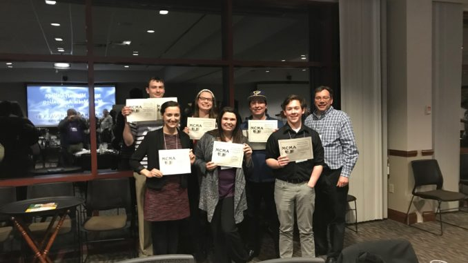 The Index executives and staff pose with certificates signifying awards from the 2018 Missouri College Media Association Convention.